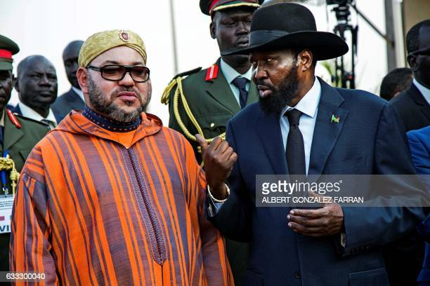 The King of Morocco Mohammed VI speaks with president of South Sudan Salva Kiir on February 1 at Juba airport at the start of his two day visit to...