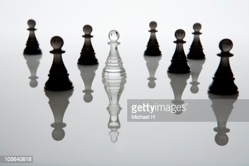 The king who lies hidden in the crowd of the pawn : Stock Photo
