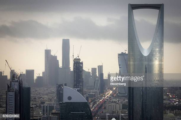 The Kingdom Tower operated by Kingdom Holding Co right stands on the skyline above the King Fahd highway in Riyadh Saudi Arabia on Monday Nov 28 2016...
