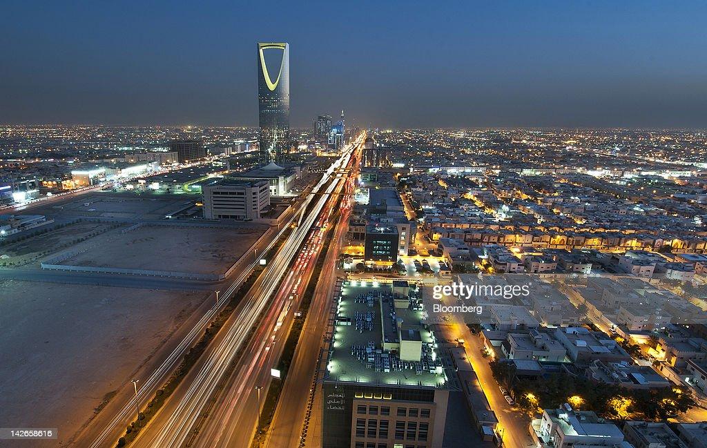 The Kingdom Tower stands illuminated at night on King Fahad Road in Riyadh Saudi Arabia on Monday April 9 2012 Saudi Arabia's gross domestic product...