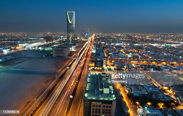The Kingdom Tower stands illuminated at night on King Fahad Road in Riyadh Saudi Arabia on Monday April 9 2012 Saudi Arabia's gross domestic product...