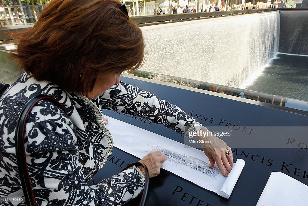 The Kings brought the Stanley Cup to Ground Zero in New York in conjunction with the National Hockey League, the Hockey Hall of Fame and the New York Police Department to pay tribute to former club scouts Garnet 'Ace' Bailey and Mark Bavis. Kathy Bavis Sylvester makes a crayon rubbing of Mark Bavis' name that is etched on the reflecting pool wall at the 9/11 Memorial site.