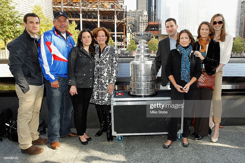 The Kings brought the Stanley Cup to Ground Zero in New York in conjunction with the National Hockey League, the Hockey Hall of Fame and the New York Police Department to pay tribute to former club scouts Garnet 'Ace' Bailey and Mark Bavis. Justin Lauri, Paul Sylvester, Colleen Bavis, Kathy Bavis Sylvester, Todd Bailey, Katherine Bailey, Barbara Pothier and Meagan Smith pose for a picture with the Stanley Cup next to the spot where their family member's names are etched on the reflecting pool wall at the 9/11 Memorial site.