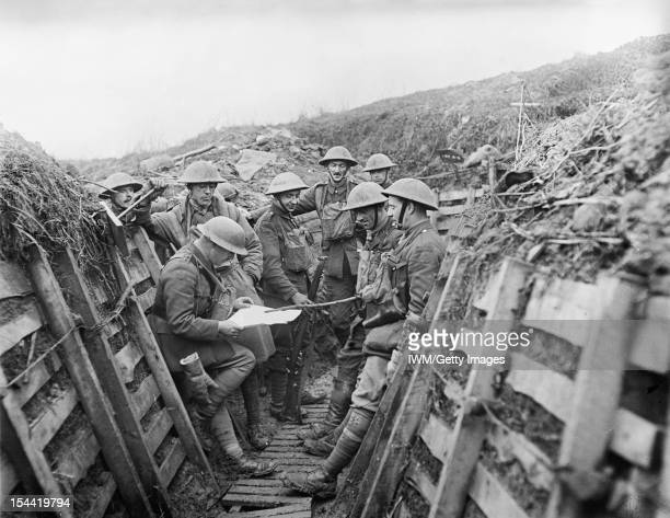 The King's Liverpool Regiment During The First World War Officers of 1/7th Battalion King's Liverpool Regiment checking a map in trenches of the La...