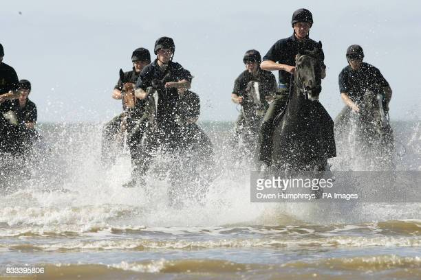 The Kings Troop Royal Horse Artillery enjoy a gallop along St Ann's beach today during a well earned break from Royal engagements in London on a...