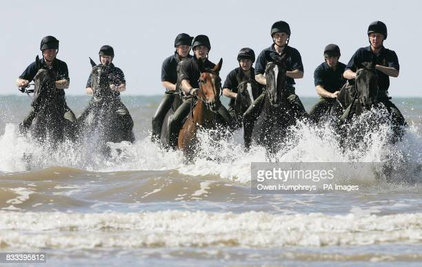 The Kings Troop Royal Horse Artillery enjoy a swim in the sea off St Ann's beach today during a well earned break from Royal engagements in London on...