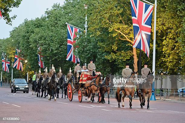 The King's Troop Royal Horse Artillery escort the first coach along the Mall leg of the route during the rehearsal of the State Opening of Parliament...