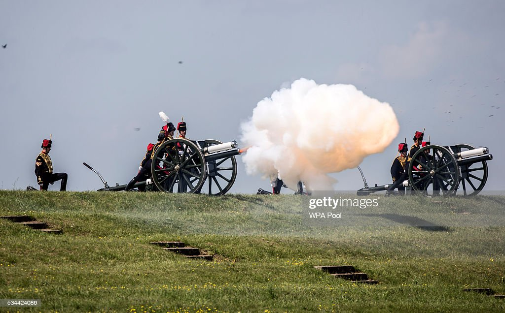 The Kings troop Royal horse artillery fire a 21 gun salute as the Queen arrives at their Larkhill camp on Salisbury plain to take part in the Artillery's 300th anniversary celebrations at Knighton Down on May 26, 2016 in Lark Hill, England. Queen Eliabeth II has been Captain-General of the Royal Regiment of Artillery since 6 February 1952.