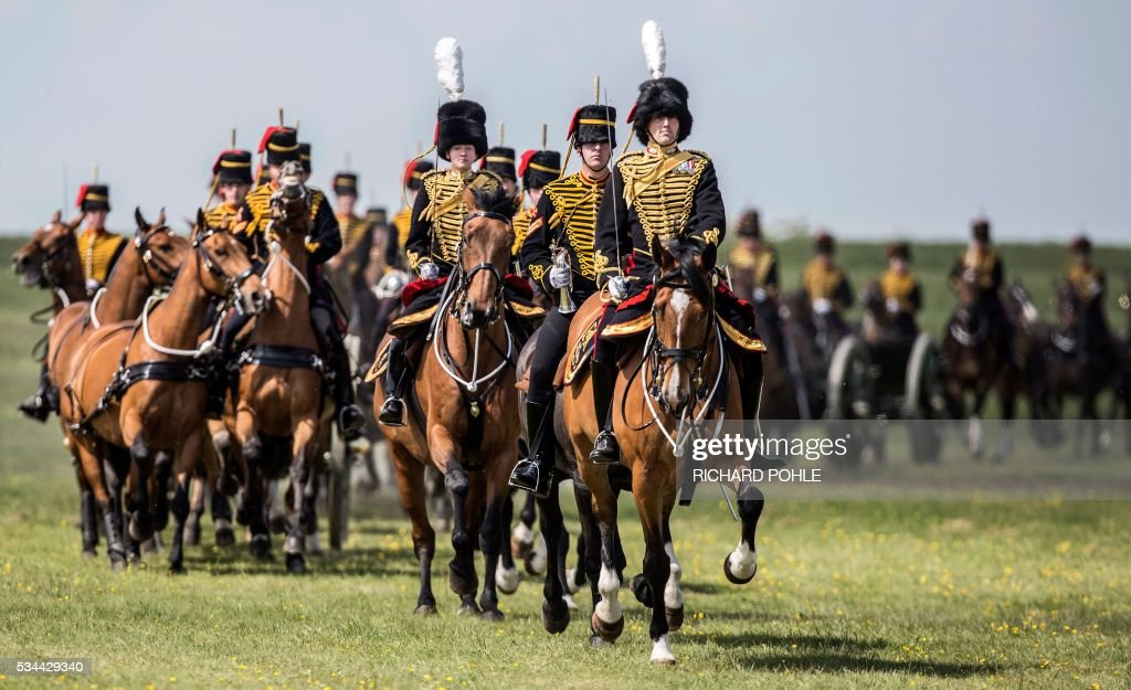 The King's Troop Royal Horse Artillery ride past Britain's Queen Elizabeth II (unseen) as she reviews the Royal Regiment of Artillery at Knighton Down, Larkhill on Salisbury plain, southern England on May 26, 2016. 2016 marks the Tercentenary of the formation of the Royal Artillery when, on 26 May 1716, by Royal Warrant of King George 1, two companies of artillery were formed at Woolwich in London, alongside the guns, powder and shot located in the Royal Arsenal. / AFP / RICHARD