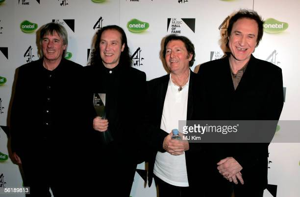 The Kinks band members Mick Avory Dave Davies Peter Quaife and Ray Davies pose backstage with the award for their induction into the UK Music Hall Of...