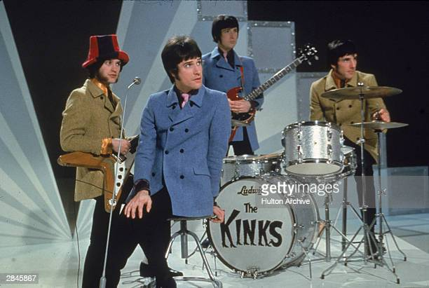 The Kinks Dave Davies Ray Davies Peter Quaife and Mick Avory wait on the set of a television show ready to perform 1968