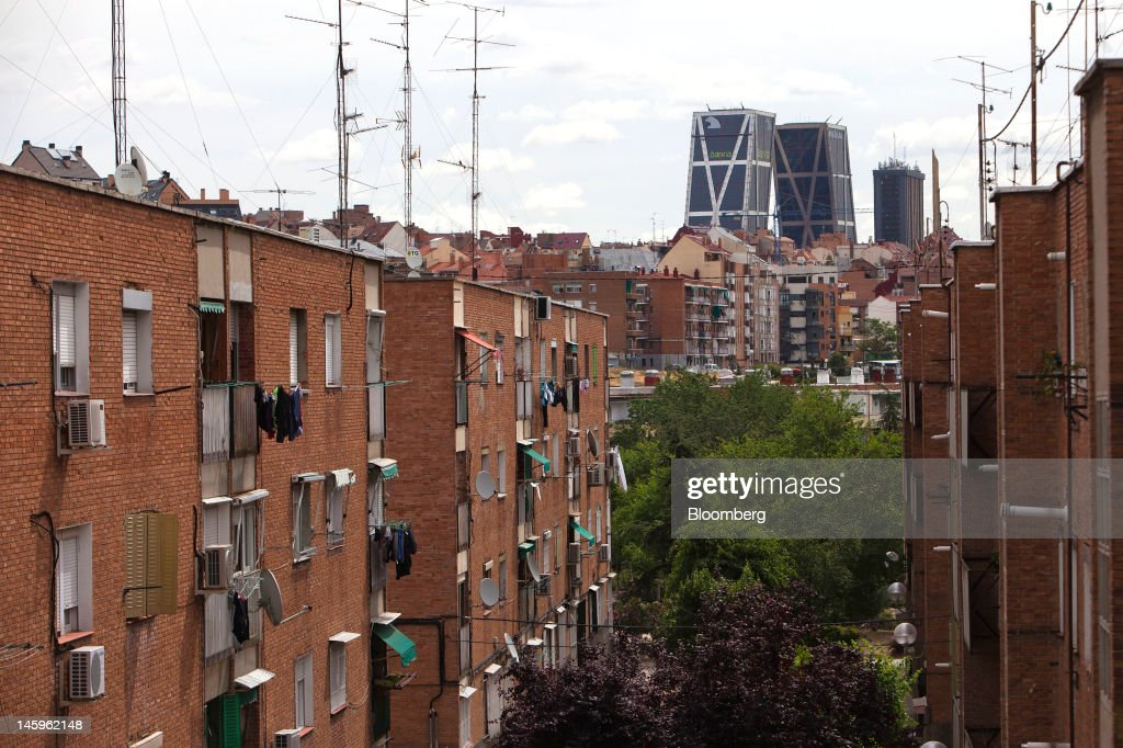 The Kio towers, headquarters of Bankia SA, are seen beyond residential apartments in Madrid, Spain, on Friday, June 8, 2012. Spain is poised to become the fourth of the 17 euro-area countries to require emergency assistance as the currency bloc's finance chiefs plan weekend talks on a potential aid request to shore up the nation's lenders. Photographer: Angel Navarrete/Bloomberg via Getty Images
