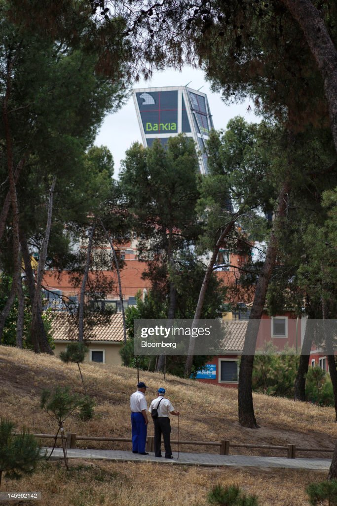 The Kio towers, headquarters of Bankia SA, are seen from a park in Madrid, Spain, on Friday, June 8, 2012. Spain is poised to become the fourth of the 17 euro-area countries to require emergency assistance as the currency bloc's finance chiefs plan weekend talks on a potential aid request to shore up the nation's lenders. Photographer: Angel Navarrete/Bloomberg via Getty Images