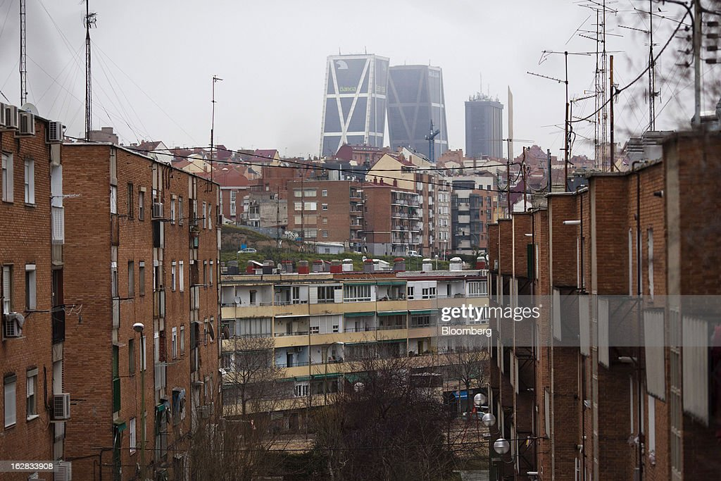 The Kio towers, headquarters of Bankia SA, stand beyond residential buildings in Madrid, Spain, on Thursday, Feb. 28, 2013. BFA-Bankia Chairman Jose Ignacio Goirigolzarri said a balance sheet clean-up that inflicted a 21.2 billion-euro ($27.6 billion) after-tax loss last year will set the Spanish banking group on course to repay state aid. Photographer: Angel Navarrete/Bloomberg via Getty Images