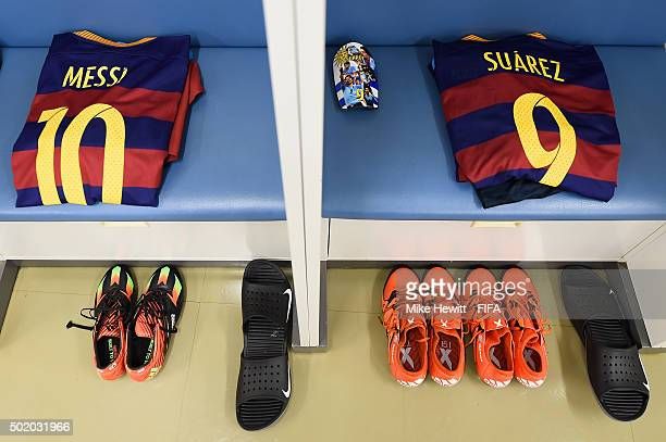 The kit of Lionel Messi and Luis Suarez is laid out in the Barcelona dressing room ahead of the FIFA Club World Cup Japan 2015 Final between River...