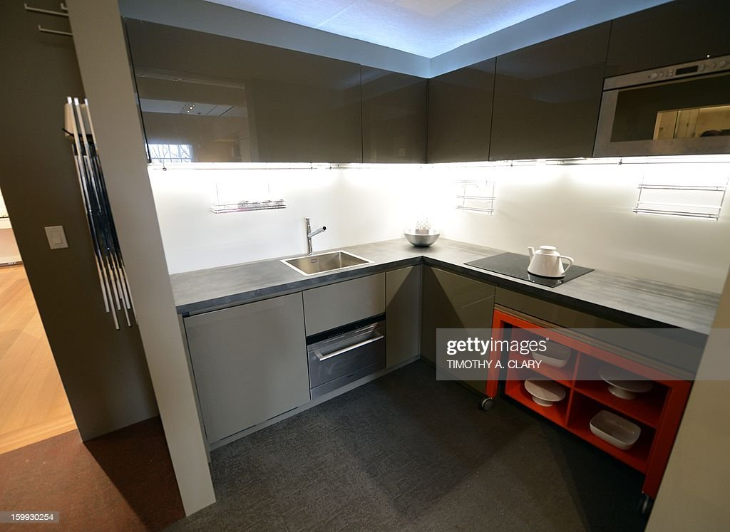 "The kitchen area inside a fully furnished 325-square-foot studio apartment during an exhibit displaying a transformable 'micro-unit' at the Museum of the City of New York January 23, 2013 during the opening of a new exhibition, 'Making Room: New Housing for New Yorkers' . New York City mayor Michael Bloomberg unveiled yesterday New York City's first ""micro-unit"" building will have apartments as small as 250 square feet."