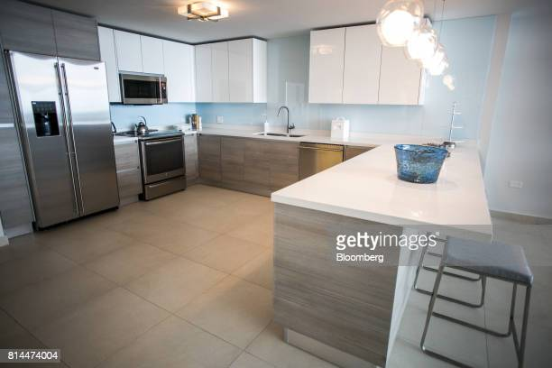 The kitchen of a showroom apartment is seen inside the Bahia Plaza residence complex at the Paseo Caribe luxury development in San Juan Puerto Rico...