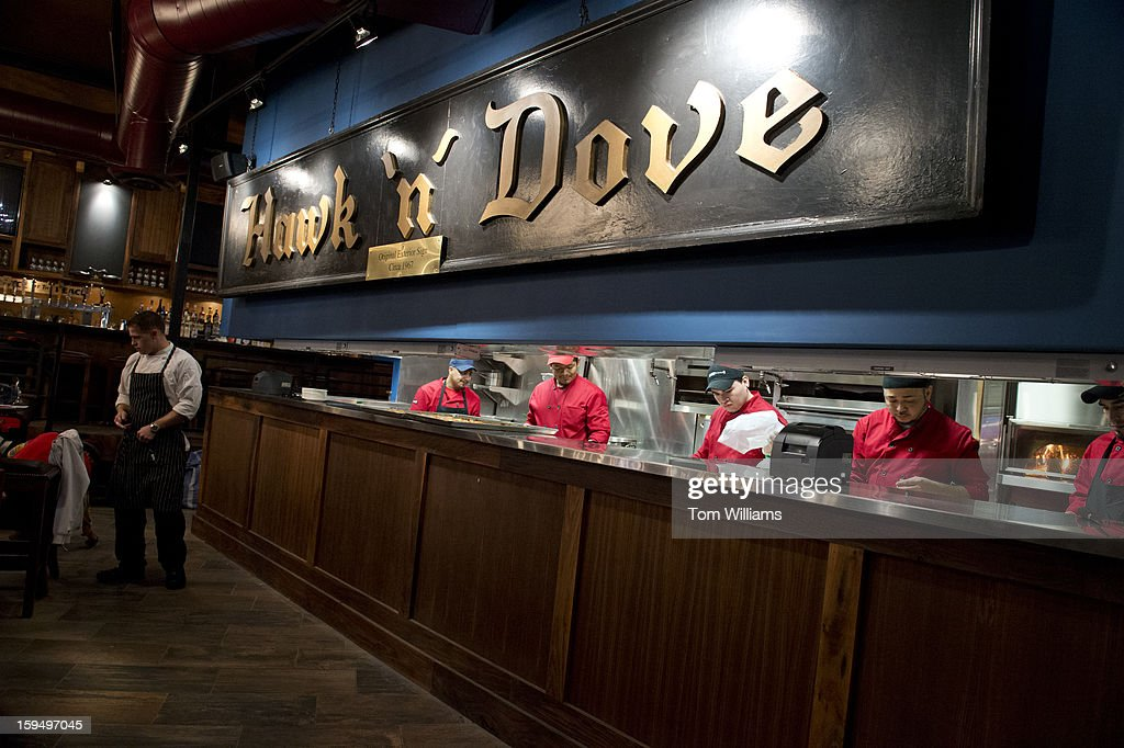 The kitchen staff of the Hawk and Dove on Pennsylvania Ave., SE, prepares for the re-opening the restaurant after a extensive renovation project. They will open for dinner on Thursday.