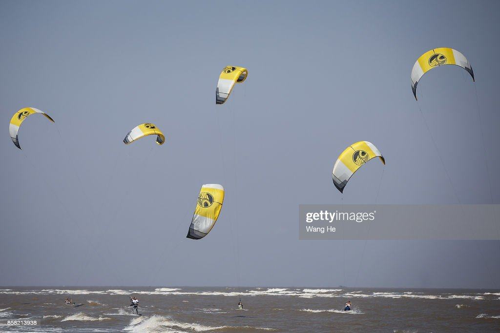 The Kite surfers competes during the 3rd Qidong YuanTuoJiao Kite Surfing Invitational Tournament on Day 1 at Qidong Golden Beach on October 6, 2017 in Nantong,Province ,China.
