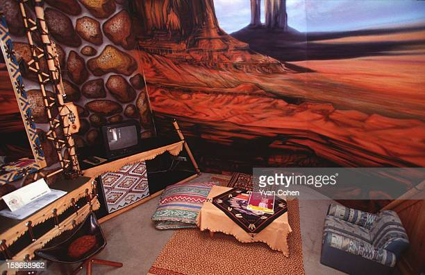 The kitsch interior of a teepee at the Pensuk Great Western resort uses painted landscapes to conjure up a prairie mood Thais come to the resort to...