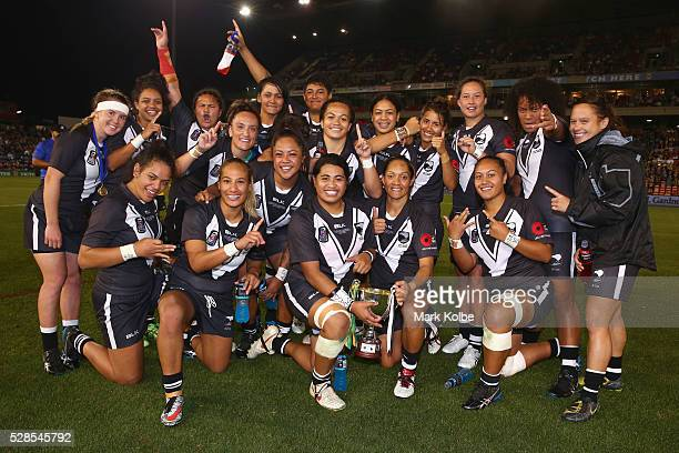 The Kiwi Ferns celebrate with the trophy after victory during the Women's international Rugby League Test match between the Australian Jillaroos and...