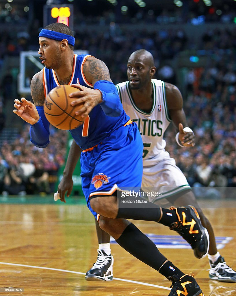 The Knicks' Carmelo Anthony, left, blows past the Celtics' Kevin Garnett, right, and he would score on the drive putting New York ahead 90-80 in the fourth quarter as the Boston Celtics hosted the New York Knicks in an NBA regular season game at TD Garden.