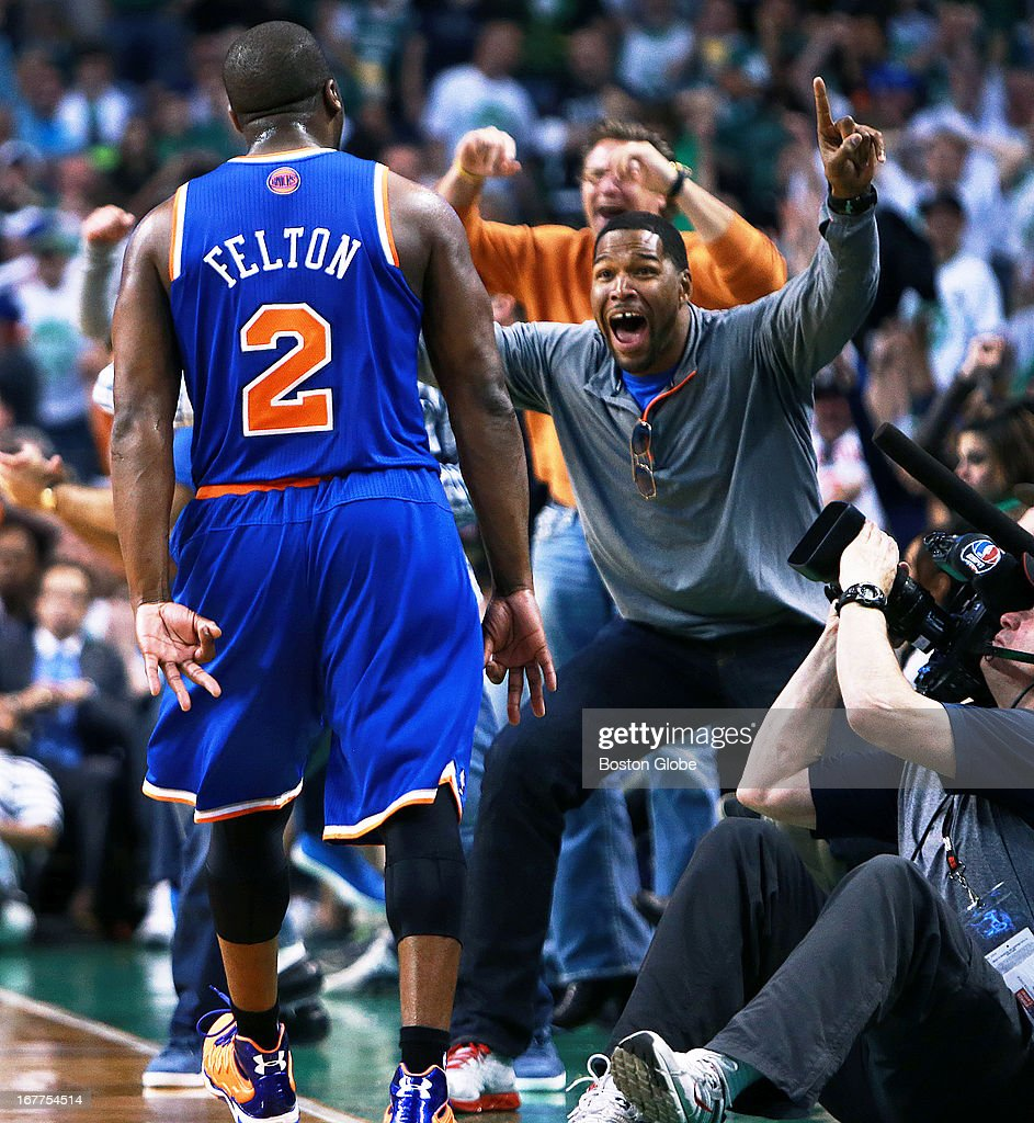 The Knicks staged big second half comeback, and one of the bigger shots was three pointer at the buzzer, ending the third quarter by New York guard Raymond Felton (#2), and the shot brought former New York Giants football star and current television host Michael Strahan, right, out of his court-side seat. The Boston Celtics hosted the New York Knicks in Game Four of an NBA Eastern Conference Quarter Final playoff series at the TD Garden.