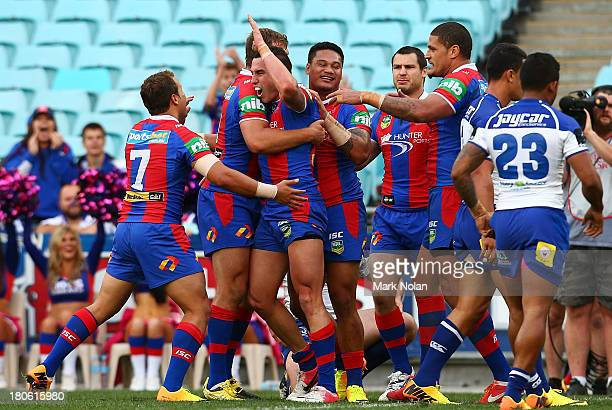 The Knights celebrate a try by Darius Boyd during the NRL Elimination Final match between the Canterbury Bulldogs and the Newcastle Knights at ANZ...