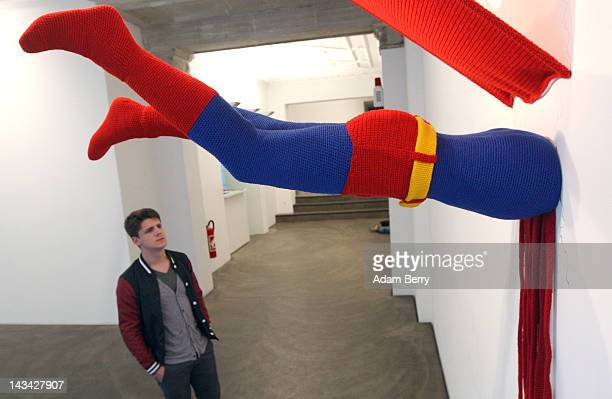 The knitted sculpture 'Superman' by Patricia Waller featuring the comic book character meeting death by his own superhuman ability to fly hangs in...