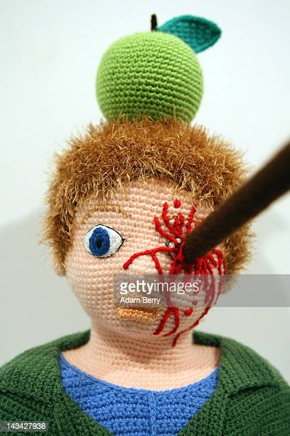 The knitted sculpture 'William Tell' by Patricia Waller sits in the 'Broken Heroes' exhibition at the Deschler Gallery on April 26 2012 in Berlin...