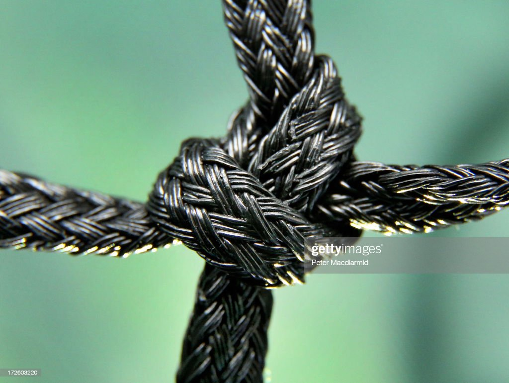 The knot in a tennis court net is seen in this close up photograph at the Wimbledon Lawn Tennis Championships on July 2, 2013 in London, England.