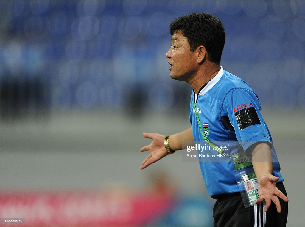 The Korea DPR Coach Yong Bong Hwang gives directions during the FIFA U-17 Women's World Cup 2012 Semi-Final match between Korea DPR and Germany at 8KM Stadium on October 9, 2012 in Baku, Azerbaijan.