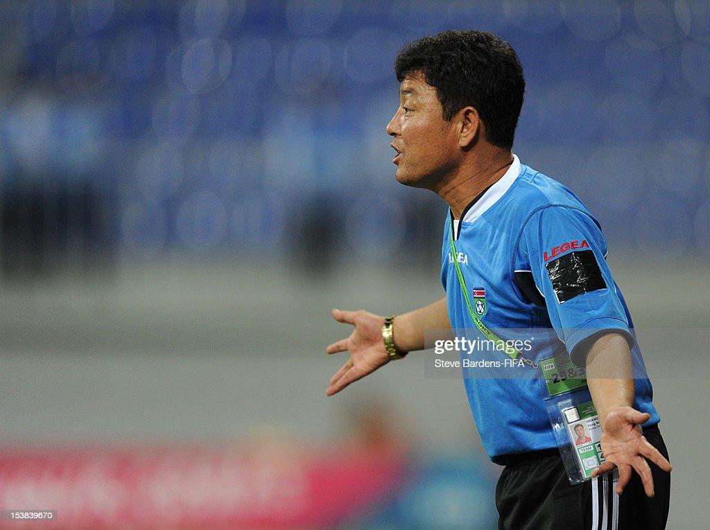 The Korea DPR Coach Yong Bong Hwang gives directions during the FIFA U-17 Women's World Cup 2012 Semi-Final match between Korea DPR and Germany at 8KM Stadium on October 9, 2012 in Baku, Azerbaijan.