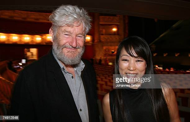 The Korean composer Unsuk Chin and German set designer Achim Freyer pose prior to the rehearsal of the opera 'Alice in Wonderland' at the Munich...