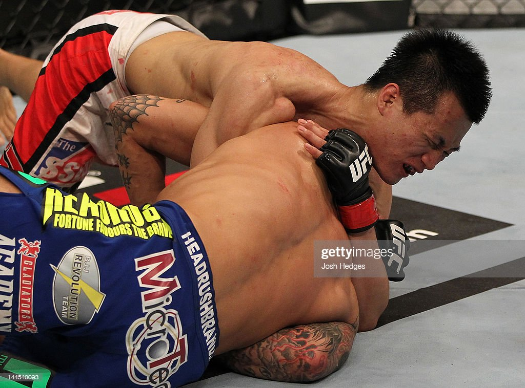 'The Korean Zombie' Chan Sung Jung defeats Dustin Poirier with a d'arce choke submission in a featherweight bout during the UFC on Fuel TV event at Patriot Center on May 15, 2012 in Fairfax, Virginia.