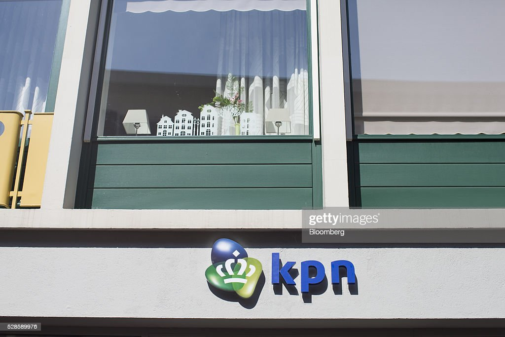 The KPN logo sits on the exterior of a Royal KPN NV mobile phone store in Nijmegen, Netherlands, on Friday, May 6, 2016. Carlos Slim's America Movil SAB is considering the sale of its minority stake in Dutch phone company KPN, less than three years after the Mexican billionaire's failed takeover attempt, according to people with knowledge of the matter. Photographer: Jasper Juinen/Bloomberg via Getty Images