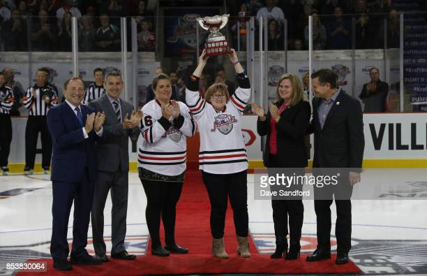 The Kraft Hockeyville trophy is presented to organizing committee member Jo Anne Wallace as NHL Commissioner Gary Bettman Sportsnets Rob Corte Angie...