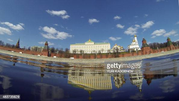 The Kremlin is reflected in the Moskva River in central Moscow on April 10 2014 AFP PHOTO / YURI KADOBNOV