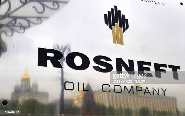 The Kremlin is reflected in the polished company plate of the statecontrolled Russian oil giant Rosneft at the entrance of the headquarters in Moscow...