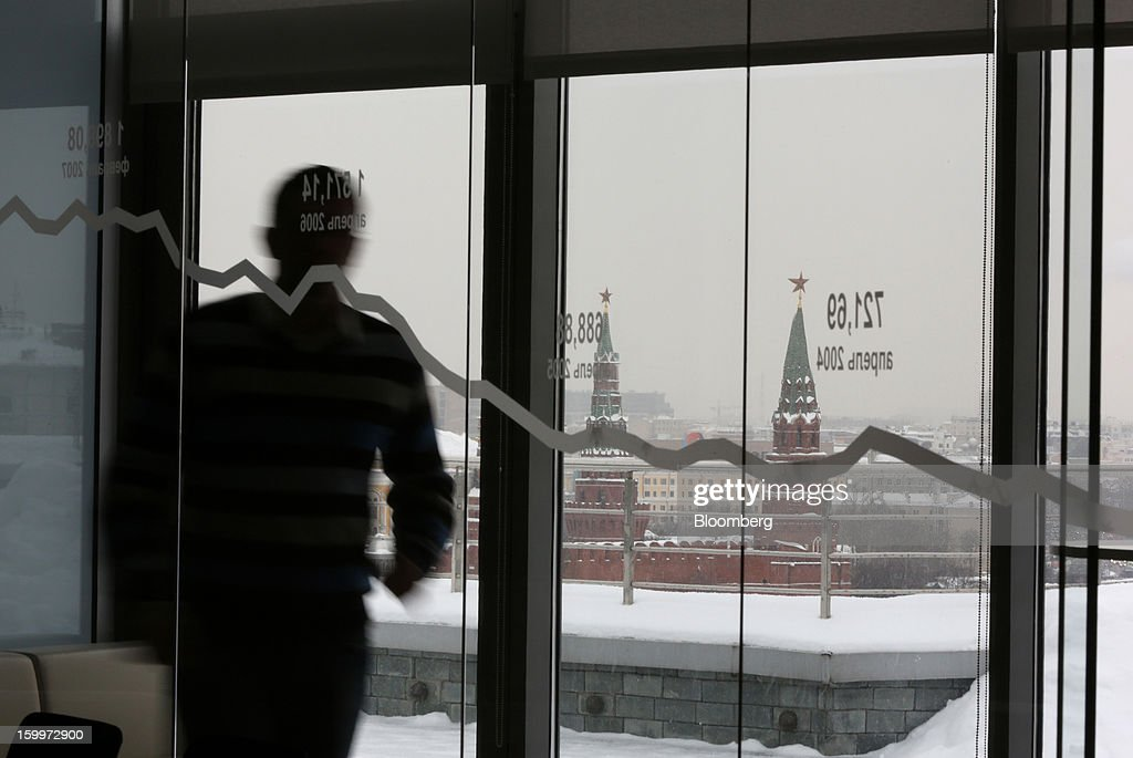 The Kremlin is seen beyond through a window displaying a stock index curve from the offices of the Moscow Exchange in Moscow, Russia, on Thursday, Jan. 24, 2013. The Moscow Exchange, Russia's biggest bourse, plans to raise more than $500 million in an initial public offering, according to a person with knowledge of the matter. Photographer: Andrey Rudakov/Bloomberg via Getty Images