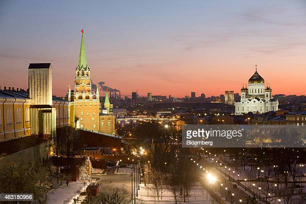 The Kremlin left and the Cathedral of Christ The Saviour right stand on the city skyline viewed at sunset from the Pozharsky Royal suite at the Four...