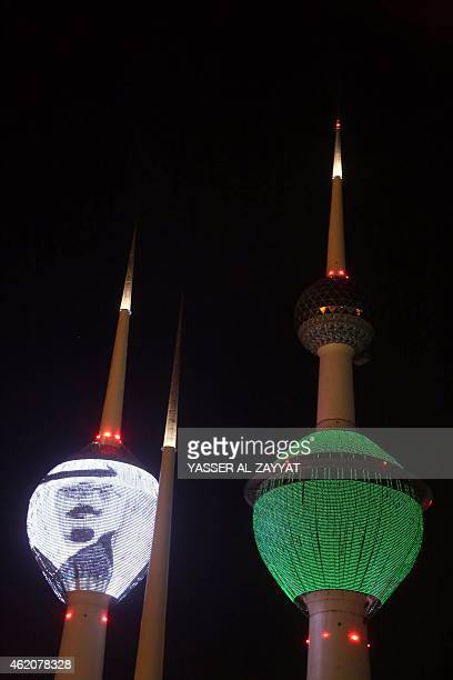 The Kuwait Towers in Kuwait City are lit up with the portrait of Saudi Arabia's late King Abdullah and the color of the Saudi flag on January 24 as a...