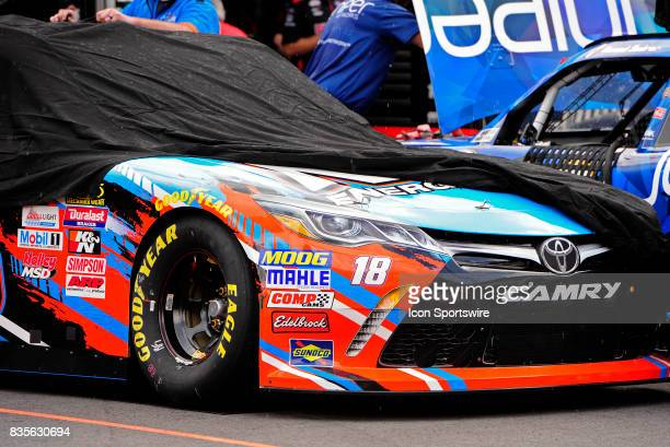 The Kyle Busch Joe Gibbs Racing Toyota Camry is covered up during a brief shower during practice for the Food City 300 on August 17 at the Bristol...
