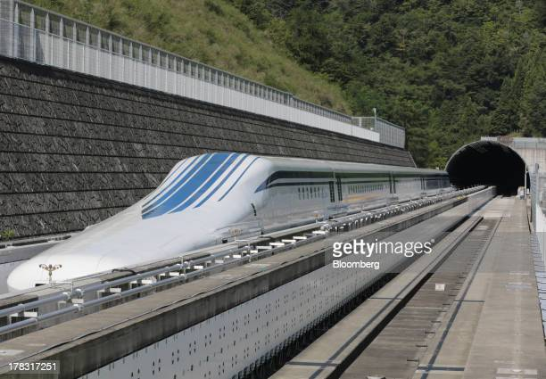 The L0 series magneticlevitation train developed by Central Japan Railway Co sits parked on a test track at the control center before a trial run in...