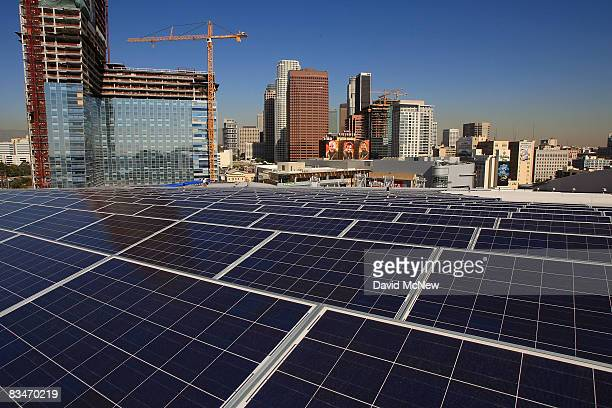 The LA Live construction project at left rises in the distance as 1727 solar panels cover the rooftop of the STAPLES Center sports complex on October...