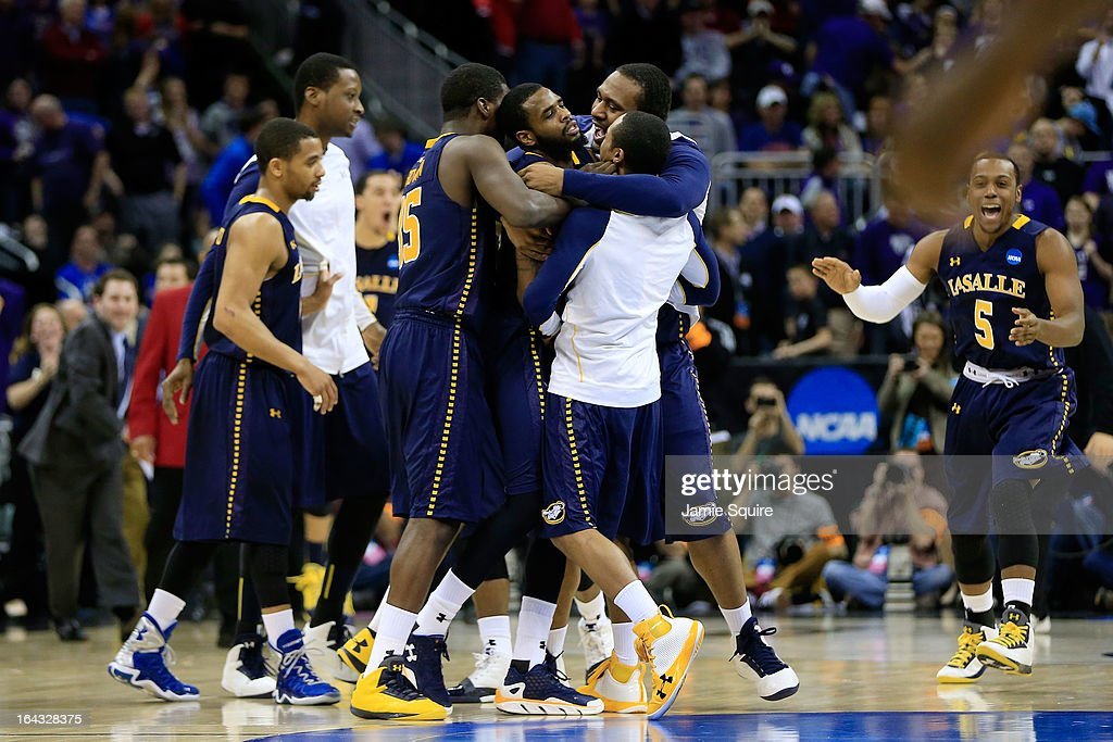 The La Salle Explorers celebrate their 63-61 win over the Kansas State Wildcats during the second round of the 2013 NCAA Men's Basketball Tournament at the Sprint Center on March 22, 2013 in Kansas City, Missouri.