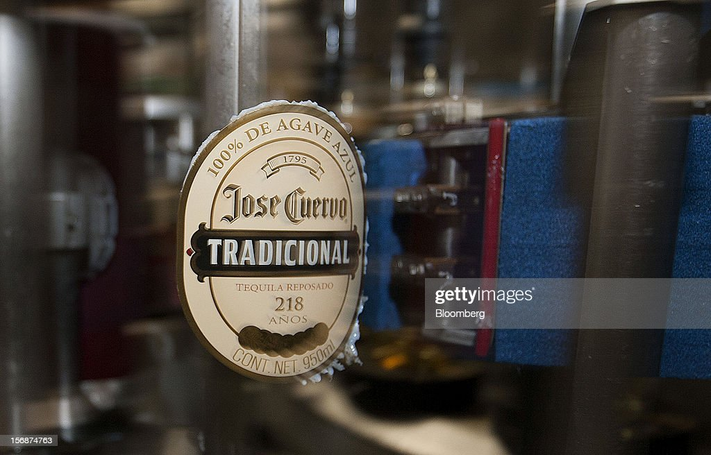The label for a bottle of Jose Cuervo Tradicional moves along the production line at the Tequila Cuervo La Rojena S.A. de C.V. bottling factory in Guadalajara, Mexico, on Thursday, Nov. 22 2012. There are more than 200 types of agave in Mexico, but use of the blue agave plant was made compulsory in the last century to the issuance of the Official Mexican Standard for Tequila production. Photographer: Susana Gonzalez/Bloomberg via Getty Images
