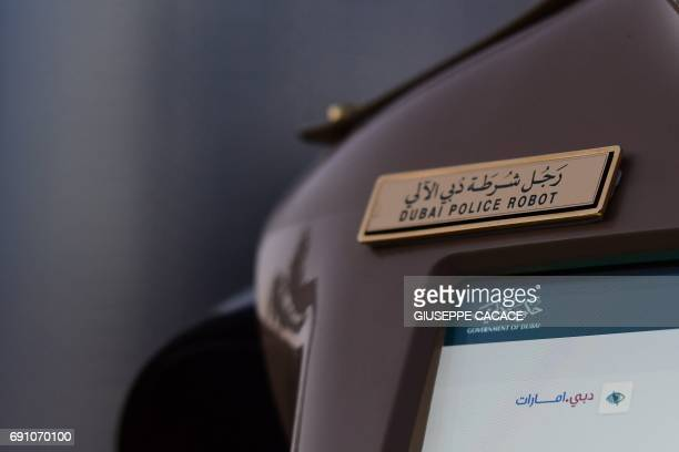 The label of the world's first operational police robot is seen as it stands to attention near the Burj Khalifa in Downtown Dubai on May 31 as a...