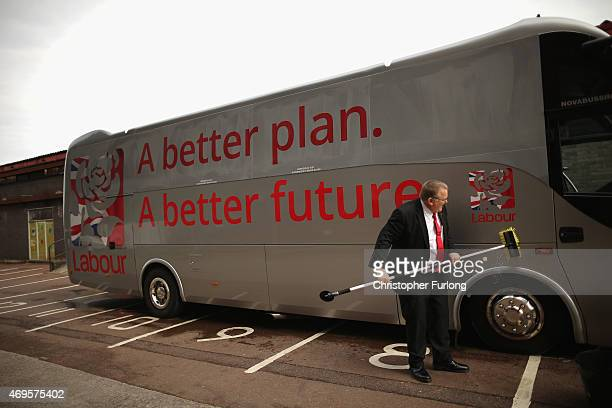 The labour 'battle' bus gets a quick clean as labour leader Ed Miliband addresses supporters during the party's launch of it's 2015 election...