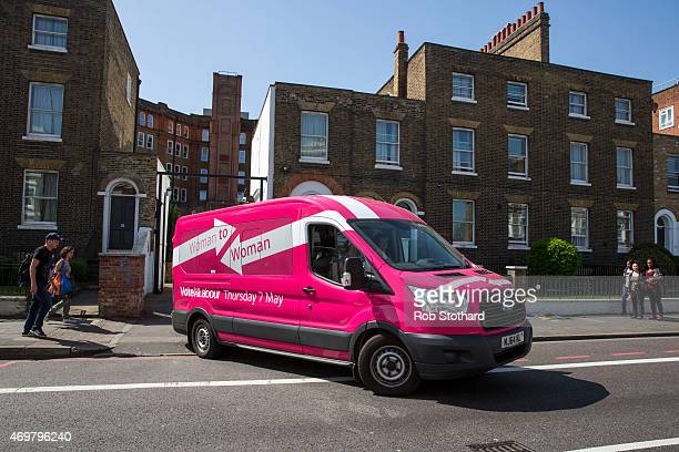 The Labour Party's 'Pink Bus' drives away from Stockwell Gardens Nursery after the launch of the Labour Party's women's manifesto on April 15 2015 in...